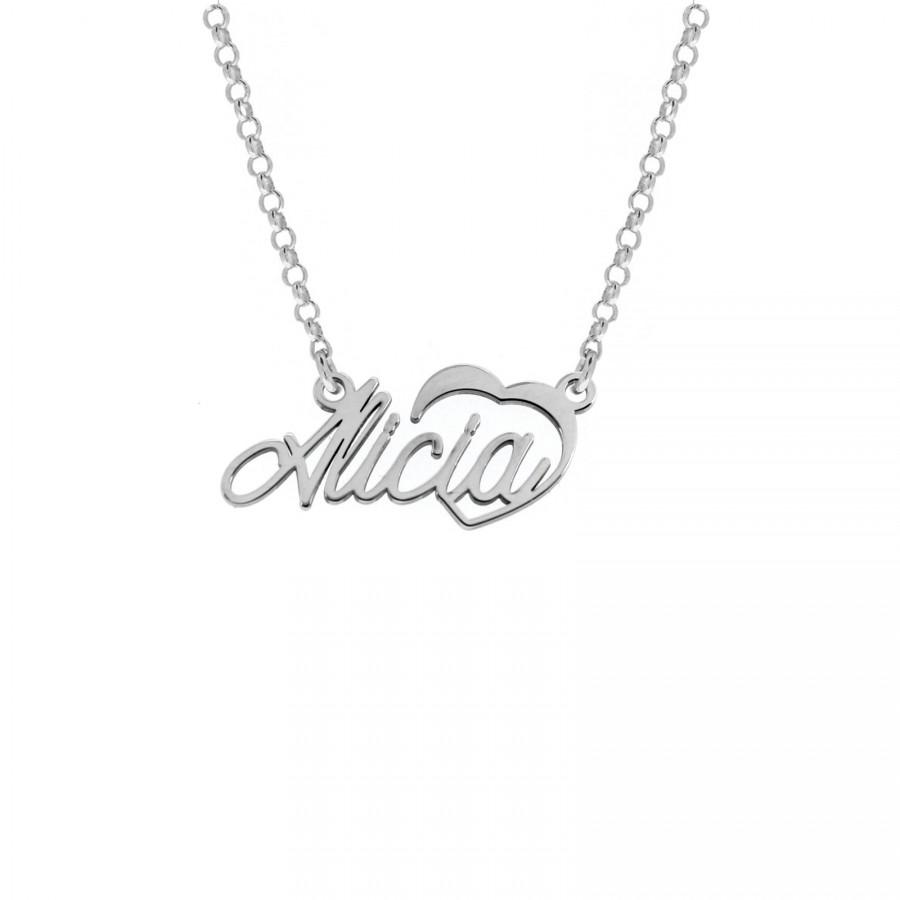 Joyas personalizadas: Collar elaborado en plata. Nombre personalizable y adorno con corazón calado